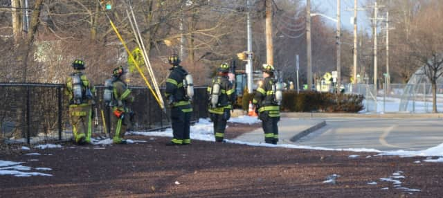 Firefighters respond to the leak at Brookside School in Allendale.