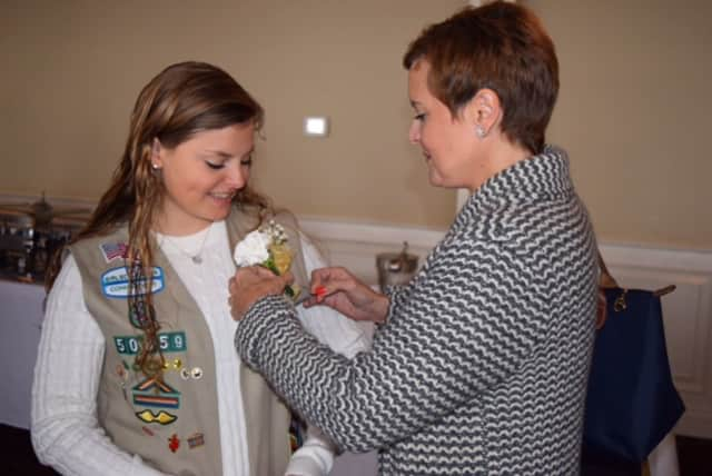Grace Herrick gets her corsage pinned by her mother, Ana Cristina Herrick, at a luncheon celebrating the centennial of the Girl Scout Gold Award. Herrick, of Newtown, is a recipient of the Gold Award.