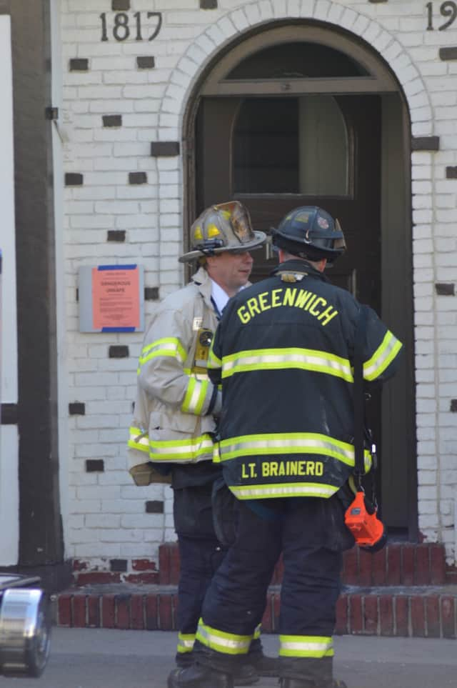 Firefighters extinguish a fire at Barcelona Wine Bar in Greenwich early Thursday morning.