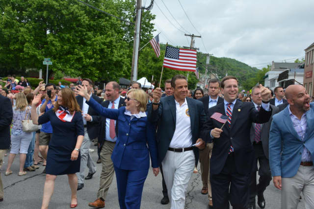 Hillary Clinton, third from left, marches in downtown Chappaqua for the 2016 Memorial Day parade. Also pictured: Town Board members Lisa Katz and Adam Brodsky, Gov. Andrew Cuomo, Assemblyman David Buchwald and Councilman Jeremy Saland.