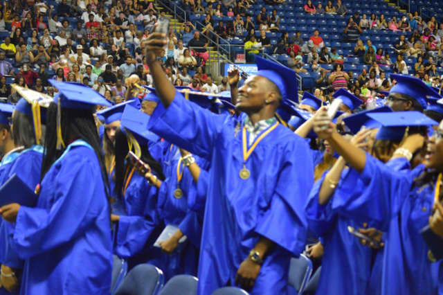 A happy graduate takes a selfie at the 2016 Harding High School graduation in Bridgeport.