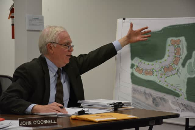 The Lewisboro Planning Board voted recently to assume lead agency status for an affordable housing application in Goldens Bridge. At an earlier meeting, planner John O'Donnell gestures towards a sketch of Wilder Balter's proposed Route 22 project.