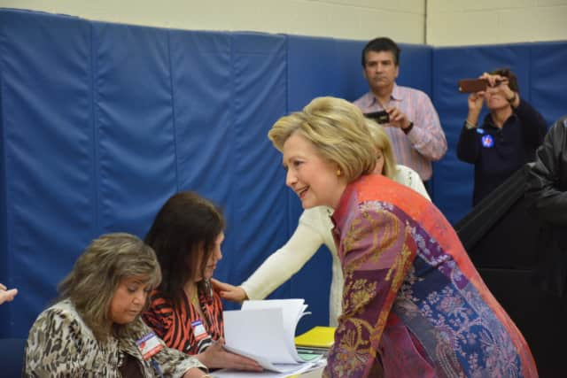 Hillary Clinton checks in to her polling place at Chappaqua's Douglas G. Grafflin Elementary School in order to vote Tuesday in New York's Democratic presidential primary.