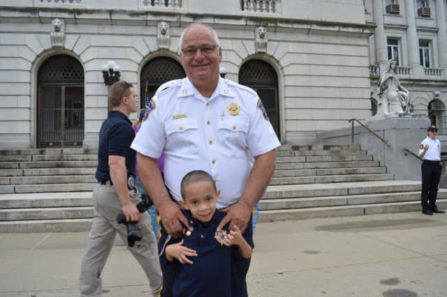 "Bergen County Sheriff Michael Saudino with his ""Chief For A Day"" Justin Pagan."