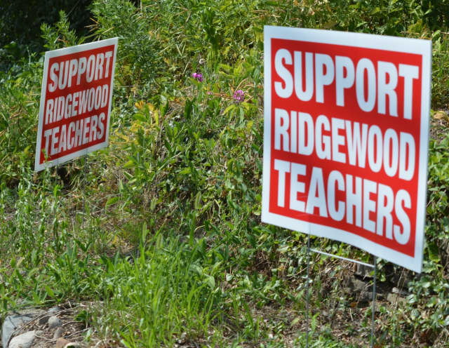 Signs in support of Ridgewood teachers are still being displayed on lawns throughout the village. Their contract expired in June 2015.