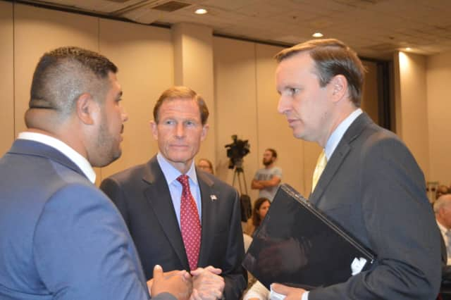 State Rep. Chris Rosario, left, speaks with U.S. Sens. Richard Blumenthal and Chris Murphy about conditions in Puerto Rico.