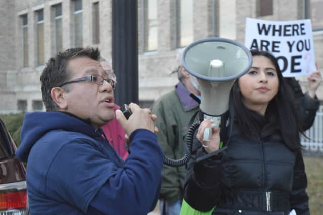 Bridgeport City Council member José Casco and Make the Road youth organizer Alison Martinez rally the crowd in support of naming Bridgeport a sanctuary city.