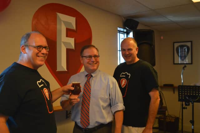 Mike Borruso, Stratford Mayor John Harkins and Joe Bow celebrate the opening of Fairfield Craft Ales.