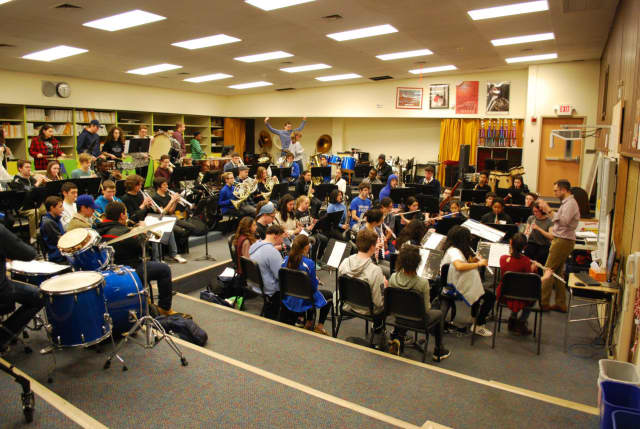 "A recent ""side-by-side rehearsal"" at Hendrick Hudson High School, during which middle school musicians had the opportunity to play alongside high school students, providing them with a unique glimpse of the high school music program."
