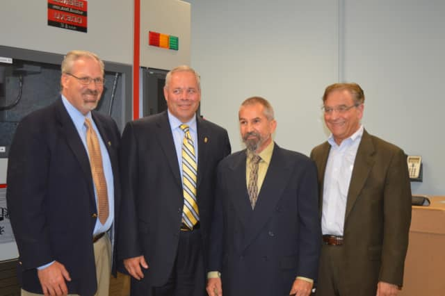 From left, Scott Wilderman, founder of Bridgeport Re-Entry Collaborative ; Corrections Commissioner Scott Semple; student Mark Newton; and Joe Carbone, president of The WorkPlace