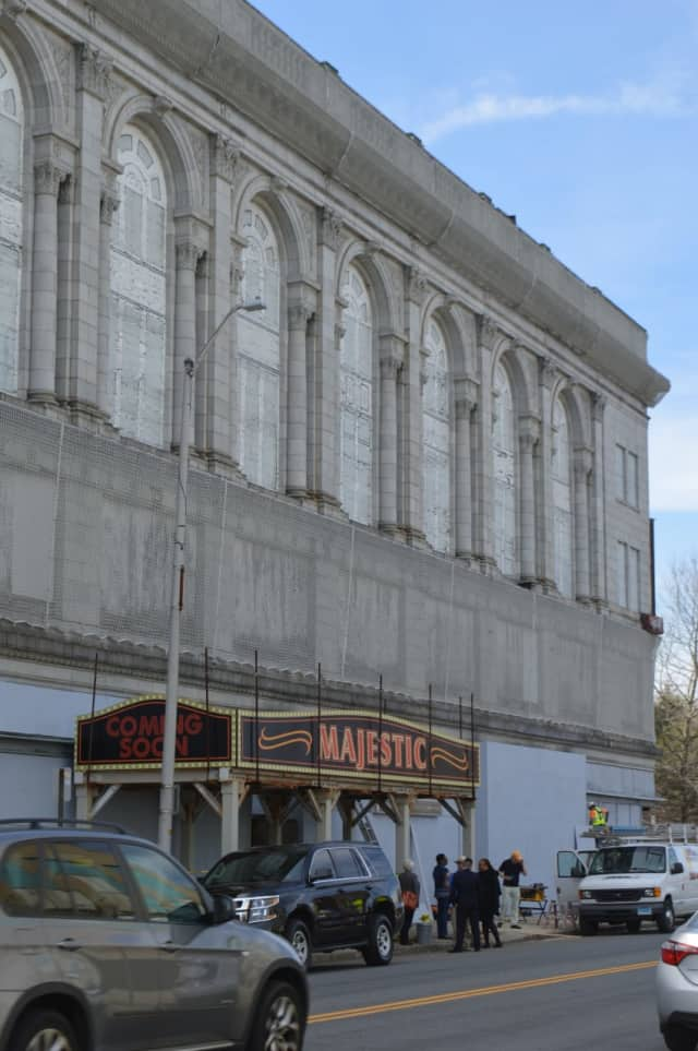 City leaders gather under a new marquee for the shuttered Majestic Theater in Bridgeport.