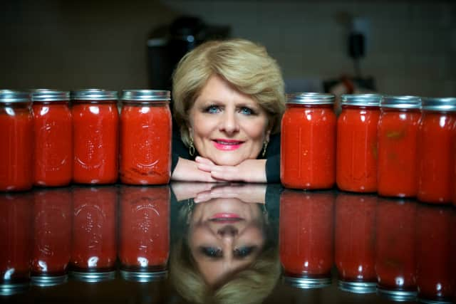Jacqueline Ruby of Waccabuc, N.Y. poses with some of her homemade sauces.