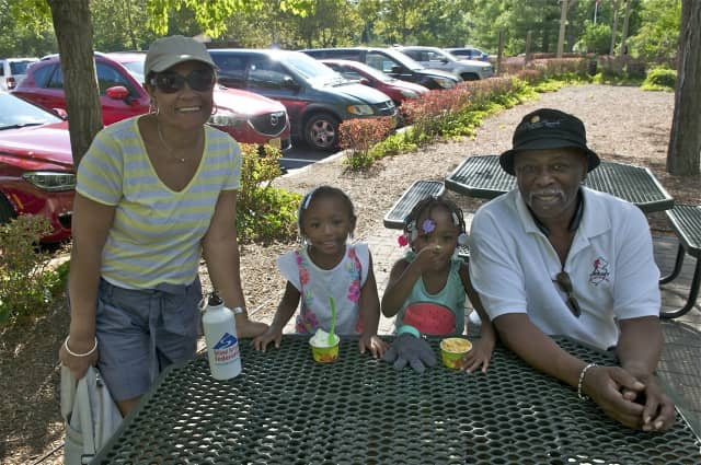 A family enjoys some ice cream at the Bergen County Zoo.