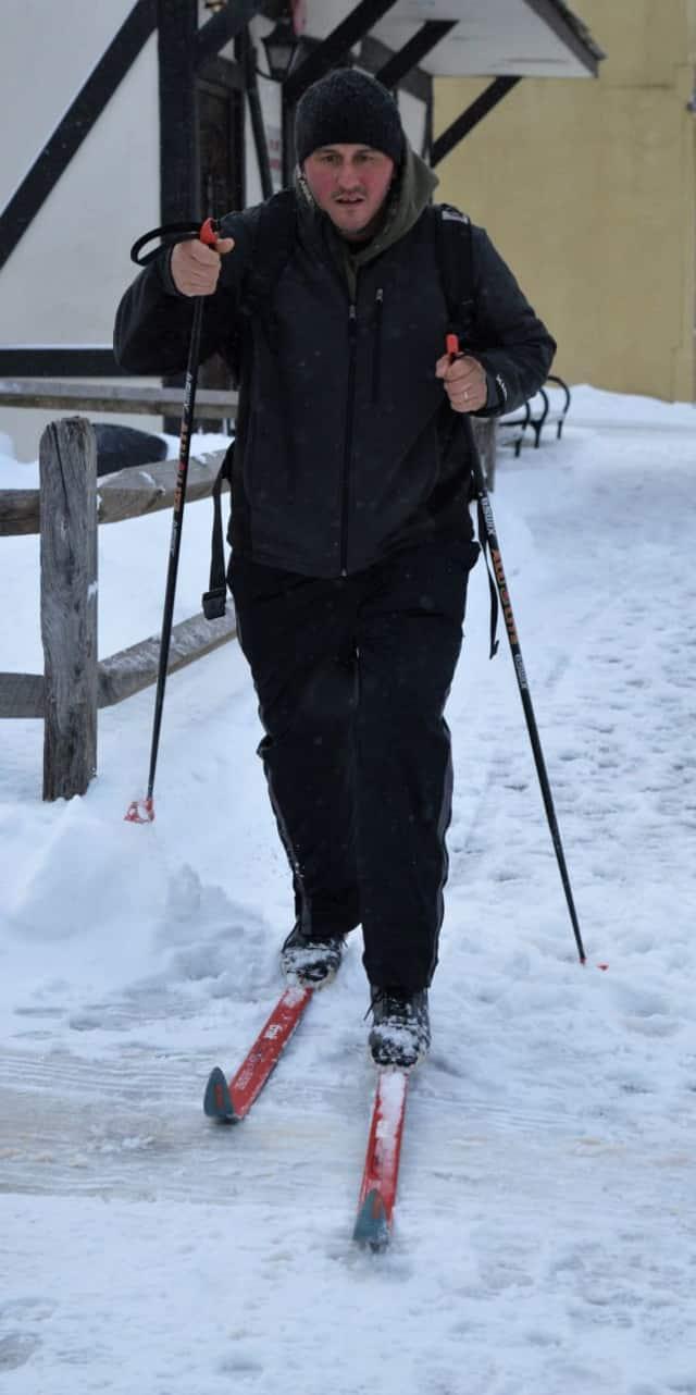 John Ferebee cross-country skiing up West Allendale Avenue in Allendale.