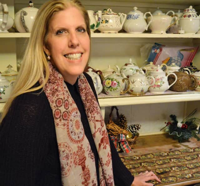 Linda Schropp with the teapot collection at the historic John Fell House in Allendale.