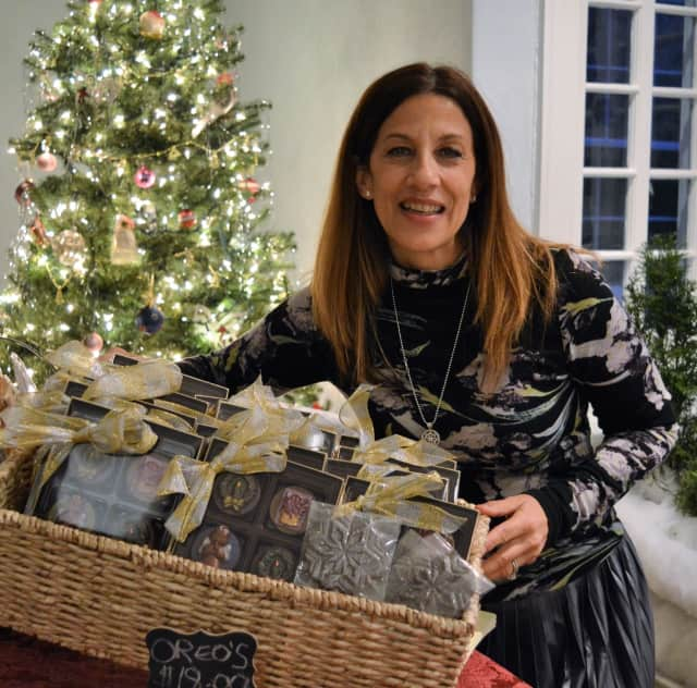 Ellen Sinopoli of Upper Saddle River with some of her handmade Cocoa Lush chocolates at Mistletoe Madness in the John Fell House in Allendale. Sinopoli is chair of the fundraising holiday shopping event.