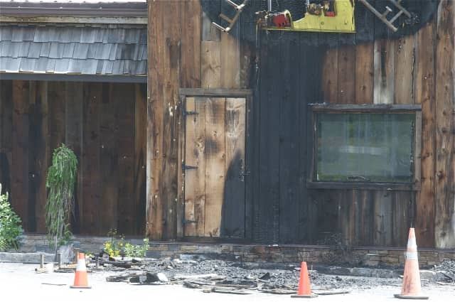 A fire at Daryl's House Club damaged parts of the front wall and the Daryl's House Club sign.