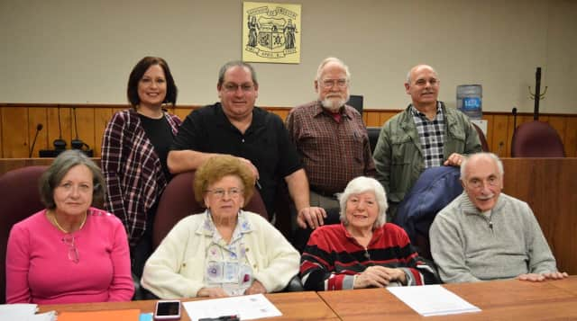 Emerson's new Historic Preservation members. Front row, from left, Frances Varoli, Ann McElwain, Marie Castrovillari, Tony Basile. Back row, Jill McGuire, Phil Mazzo, Bill Wassmann, Vincent Benanti.