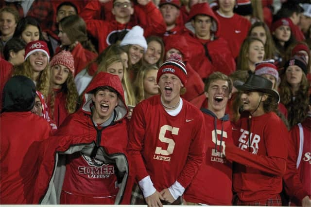 Somers 12th Man support group cheers on the Tuskers at Kingston's Dietz Stadium.