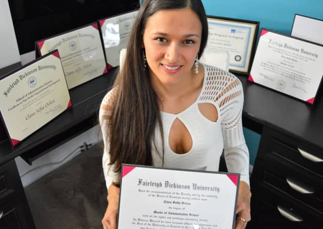 Clara Sofia Ochoa in her Hackensack apartment, surrounded by her academic degrees and certificates from Colombia and the U.S.