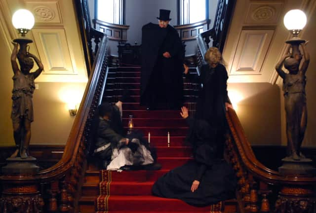 Halloween at the Lockwood-Mathews Mansion Museum with Volunteer Ghosts Paul and Hadley Veeder, Rose Carroll, and Midge Lopat.