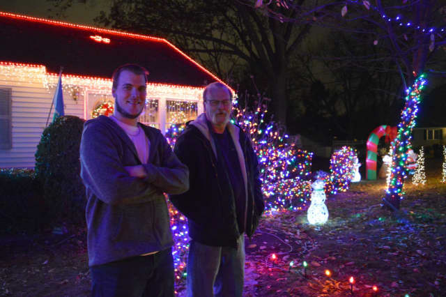 Kevin, left, and Wayne McCarthy of Paramus spend weeks programming their annual Christmas lights display.