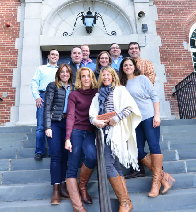 The Ridgewood High School Alumni Association Commemorative Brick Committee on the steps of the school.