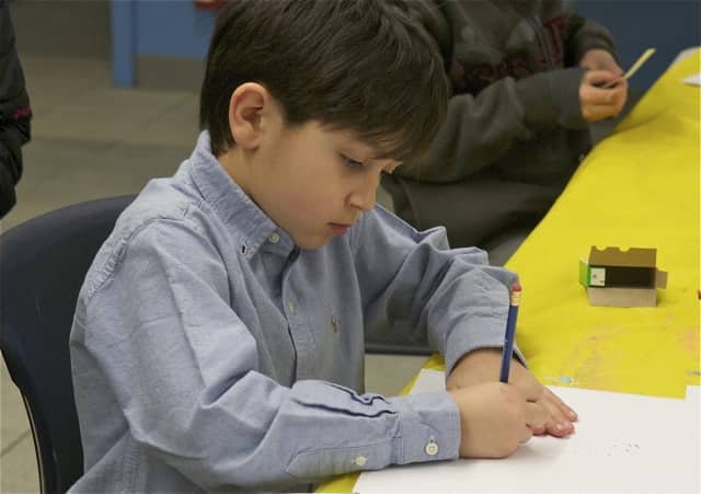 "A child working on a craft project at the Brookfield Library. The Brookfield Library is hosting a ""Fun and Friends Hour"" for kids ages 6 months to 5 years old May 11."