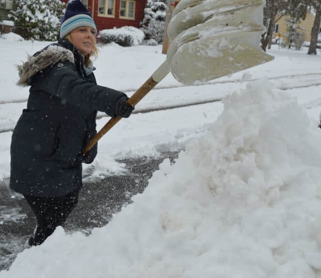 Teri Rabolli of Allendale shovels up a small mountain outside her Allendale home.