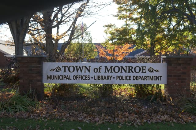 The Monroe Town Council has trimmed next year's budget by from $85.47 million to $85.38 million by eliminating pay increases for part-time employees and other minor adjustments.