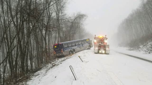 State police ask residents: Stay off roads if you can. If you must go out, reduce speed and give plows plenty of space. The bus crash above is on Route 2 in Marlborough. No passengers were onboard, and injuries were minor, state police said.