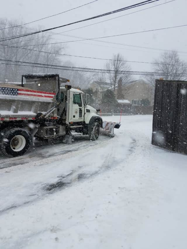 A city plow pulls out onto Haig Avenue in Stamford during Thursday's storm.