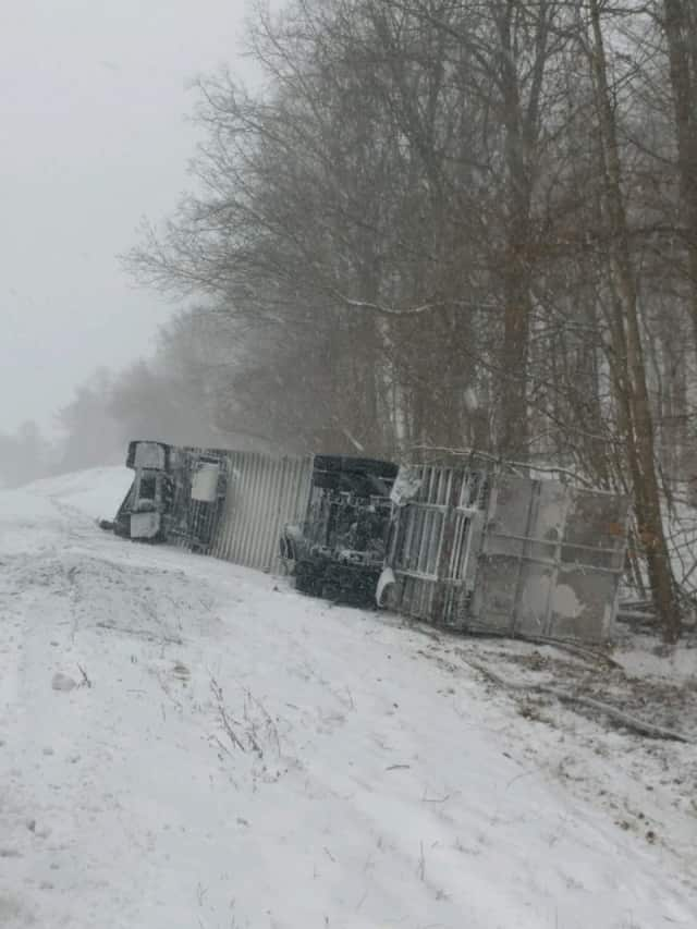 The tractor-trailer overturned after crashing down the embankment on I-84 in Fishkill.