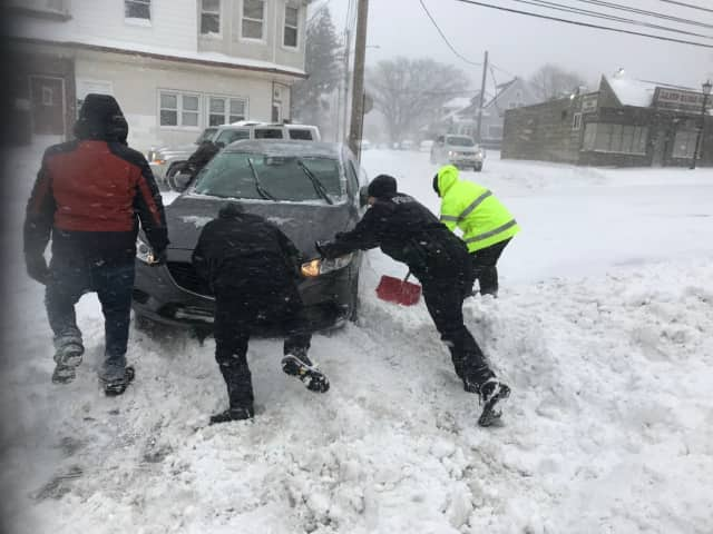 Stratford officers help dig a stranded motorist out of the snow on Thursday
