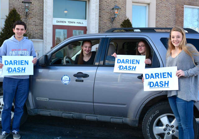 "Darien Youth Commission members at the town hall, Ben Bidell, Amanda Barlow, Alyssa Farrell and Samantha Ball. Register will begin Monday for the DYC ""Darien Dash"" scavenger hunt."