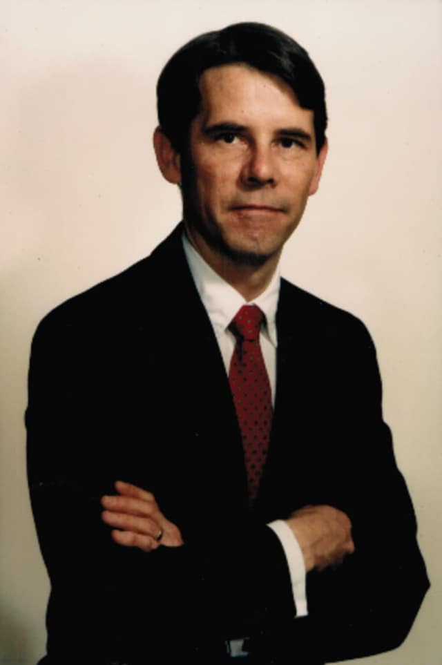 Paul G. Hughes of Stamford.