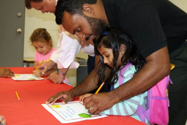 """Hundreds of men took part this week in """"Dads Take Your Child To School Day"""" at the Alice E. Grady Elementary School and the Carl L. Dixson Primary School in Elmsford."""