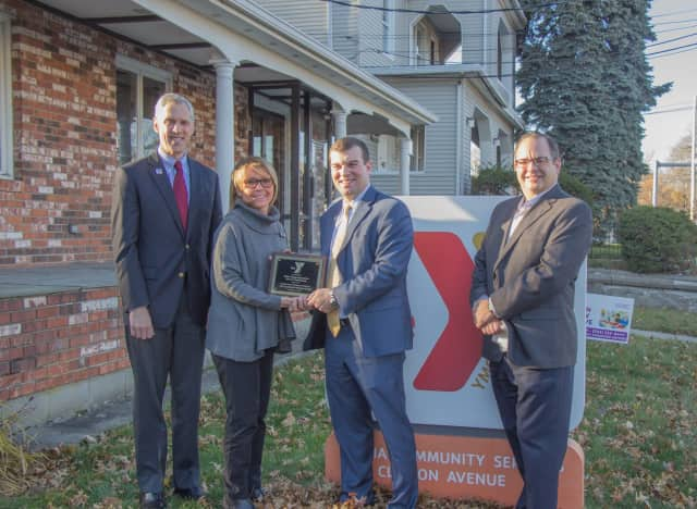 David Stevenson, president and CEO of Central Connecticut Coast YMCA, Carmen Colon, vice president of the Bridgeport Ys, Steve Stafstrom and John Cattelan, executive director of CT Alliance of YMCAs stand outside the Y's Clinton Avenue site.