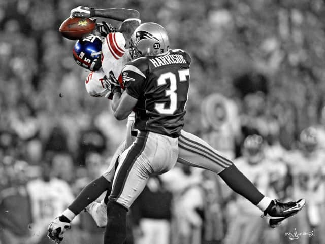 "David Tyree making his famous ""helmet catch"" at Super Bowl XLII."