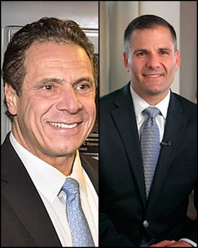 "New York Gov. Andrew Cuomo of New Castle and Dutchess County Executive Marc Molinaro, a Republican who is turning up the heat on the governor's federal ""pay-to-play"" corruption probe."