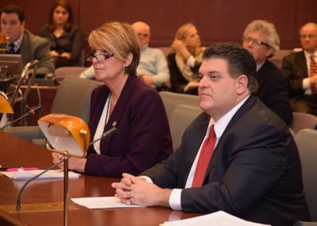 State Reps. David Rutigliano and Laura Devlin have called for a vote on a controversial UConn labor contract.