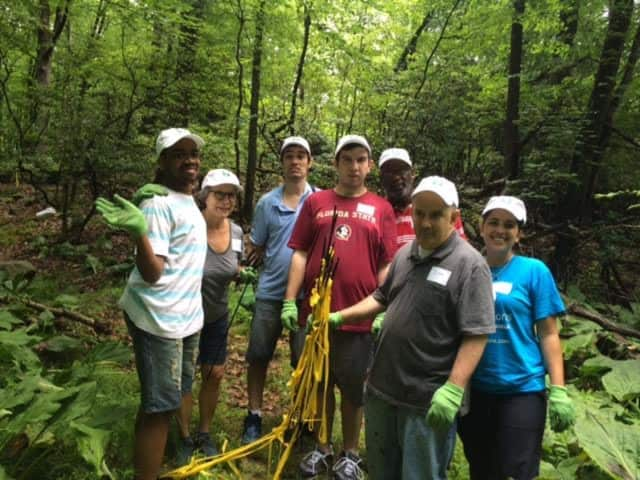 Disabled adults helped rehab trails at the Onatru Farm and Preserve this week.