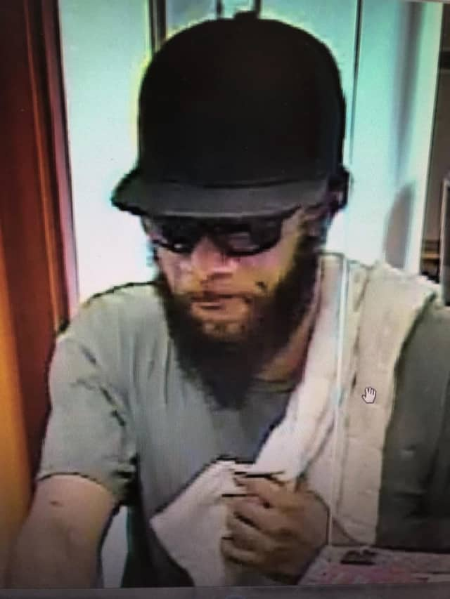 Police are searching for this man who is accused of robbing a bank.