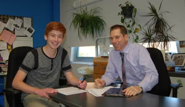 Byram Hills senior Dominick Rowan with David Keith, director of the high school's Authentic Science Research Program.