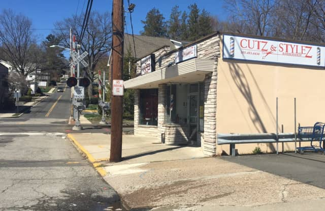 This building, which houses both a vape shop and a barber shop, is part of a proposed redevelopment area