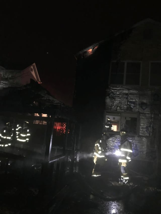 A fire in a Stamford gazebo spread to an area home.