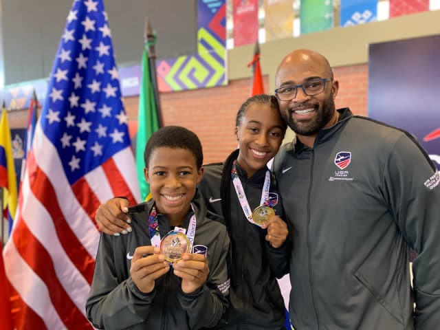 Greenwich brother and sister, Myles and Madison Ducket, with their father Richard Duckett, show the medals they won at the Pan American Youth Championships in Bolivia in August.