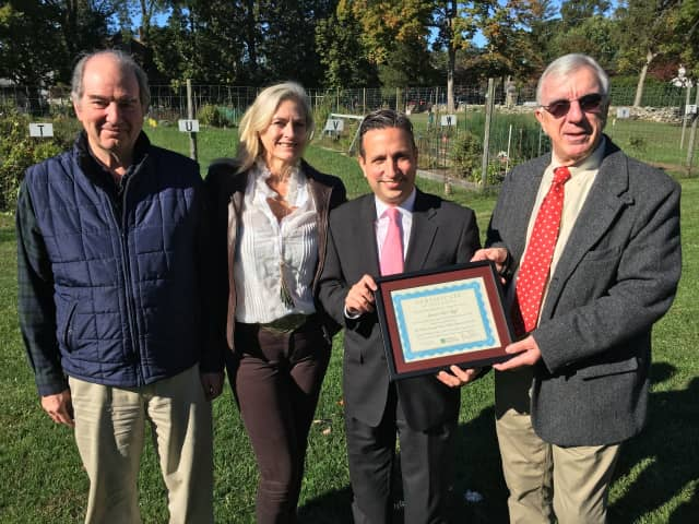 Norwalk Land Trust officials, left to right, Seeley Hubbard, past president; Vickie Bennett, board member, and John Moeling, president, present Senate Majority Leader Bob Duff, center, with a citation for service at Fodor Farm in Norwalk.
