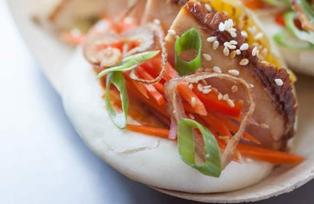 A recipe for asian-inspired steamed buns won a $10,000 scholarship for two Culinary Institute of America students.