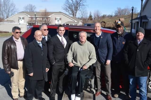 Dutchess County Legislator Marc Coviello and Representative Sean Patrick Maloney with Beacon veteran Joseph Deweever and his new handicapped-accessible van.